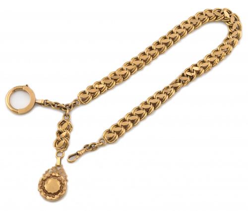 Leontina trenzada en oro de 18K de pps s XIX con guardapelo