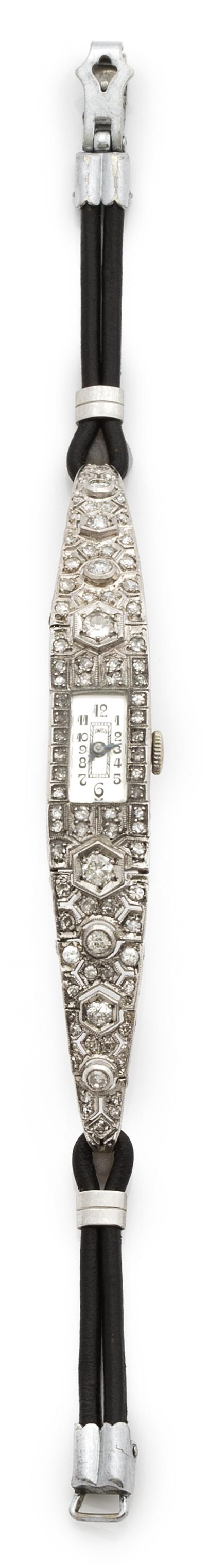 Reloj Art-Decó de brillantes y platino con pulsera de piel.