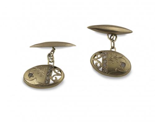 Gemelos Art-Nouveau ovalados con decoración vegetal y calada