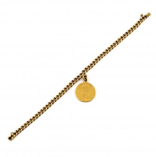 Pulsera de eslabón barabado en oro amarillo de 18K. con mon