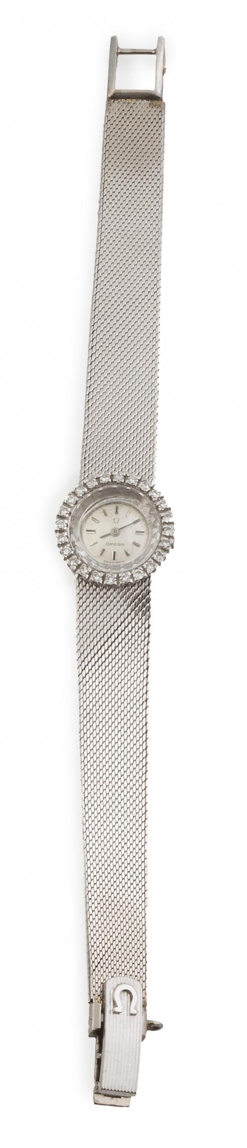 Reloj OMEGA años 60 en oro blanco de 18K orlado de brillant