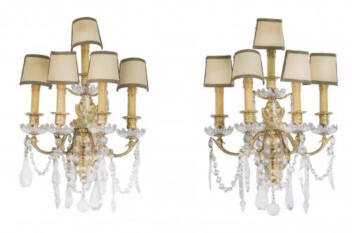 Pareja de apliques de seis brazos de luz bronce y cristal.
