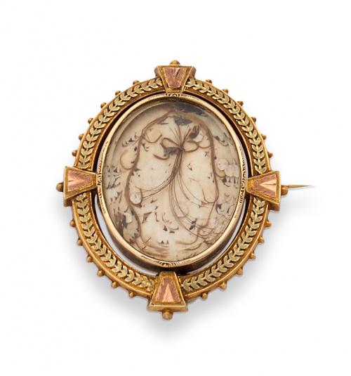 Broche guardapelo s.XIX con marco oval en oro bicolor de 18