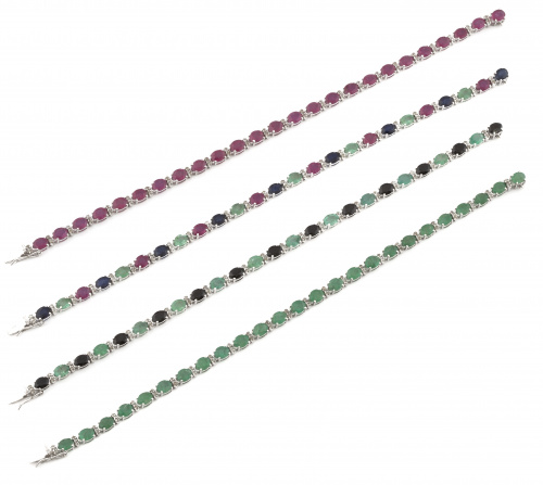 Pulsera rivière de rubíes zafiros y esmeraldas entre pareja