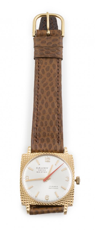 Reloj CAUNY años 60 en acero y metal dorado