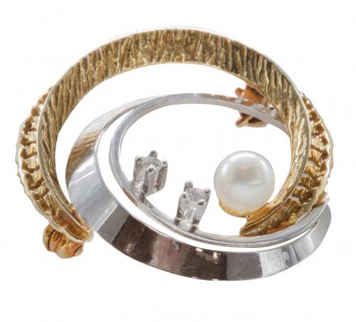 Broche circular calado en oro bicolor con perla y dos zafir