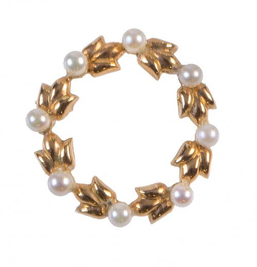 Broche circular en forma de guirnalda con perlitas alternas