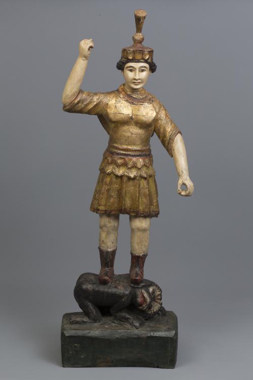 Talla de indio sobre una bestia de madera tallada y policro