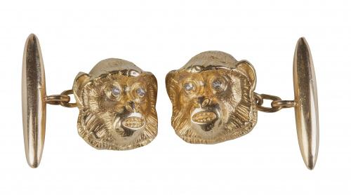 Gemelos de pp. S. XX con diseño de cabeza de mono con ojos