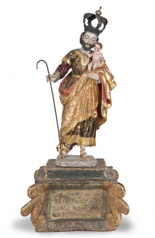 San José con el Niño.Escultura en madera tallada, policro