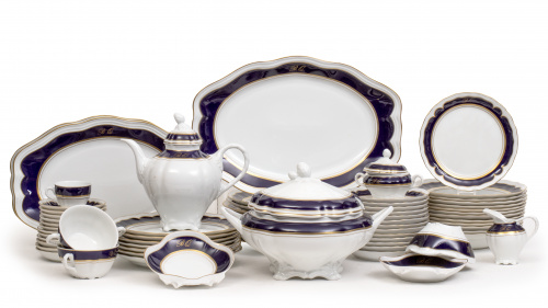 Vajilla  en porcelana blanca con filo azul y dorado e inici