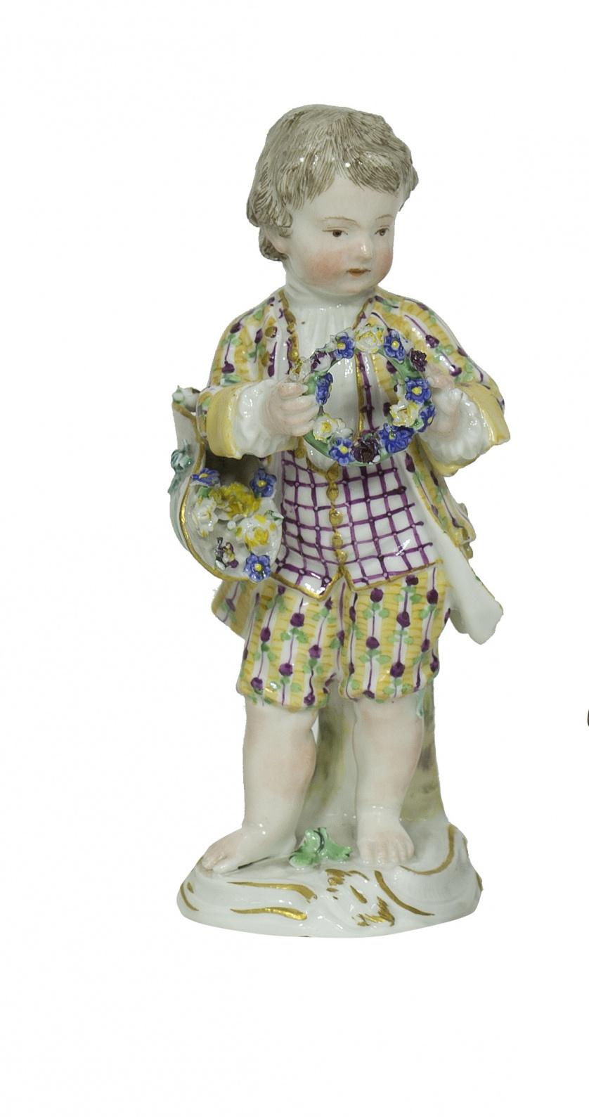 Niño con orla de flores y cesto.Samson, S. XIX