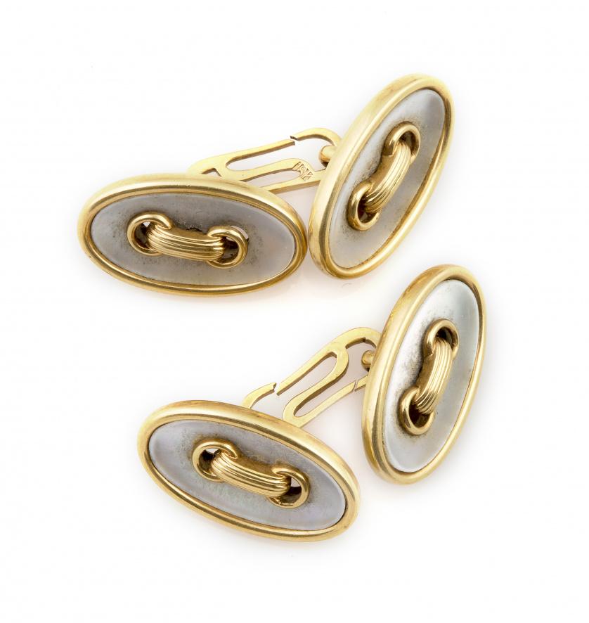 Gemelos dobles de pp. s.XX en forma de botones ovalados en