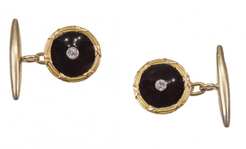 Gemelos circulares de pp. S. XX con esmalte negro, brillant