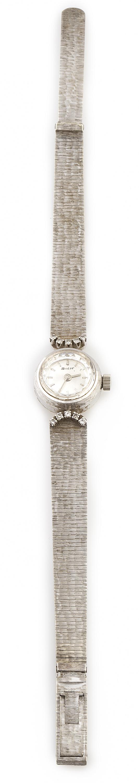 Reloj SUTER años 60 en oro blanco de 18K con arcos de brill