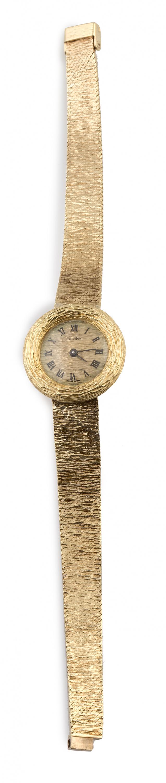 Reloj DOGMA años 60 en oro amarillo matizado de 18K