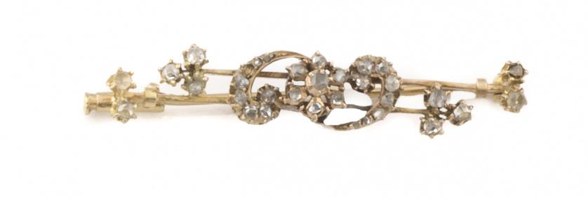 Broche de pp s.XX con flores y arcos de diamantes.