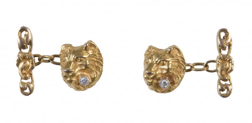 Gemelos Art Nouveau con cabeza de león con brillante en la