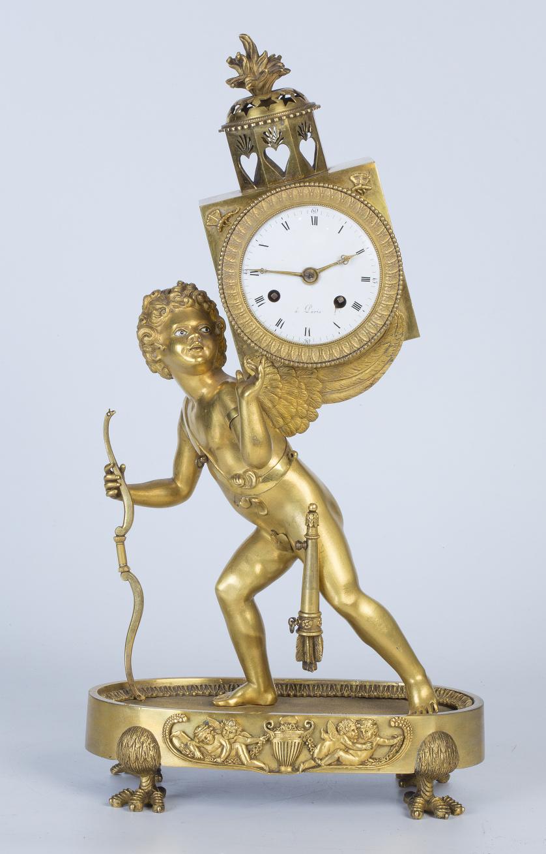 Reloj Luis XVI con Cupido en bronce dorado.Trabajo francé