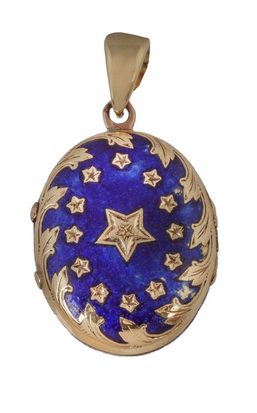 Colgante guardapelo S.XIX oval, con esmalte azul y decorac