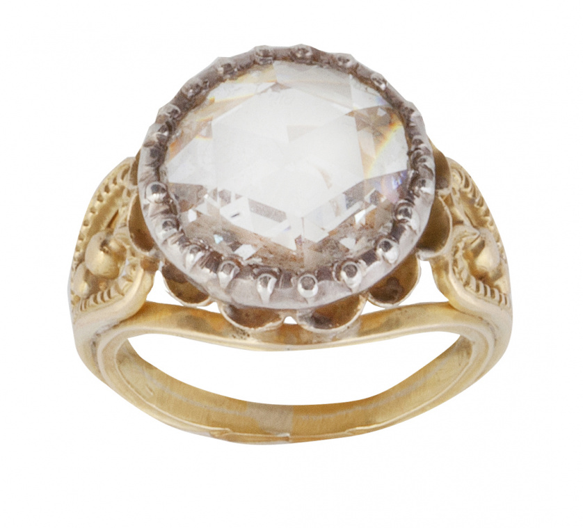 Sortija solitario con diamante de talla redonda rosa de ff.