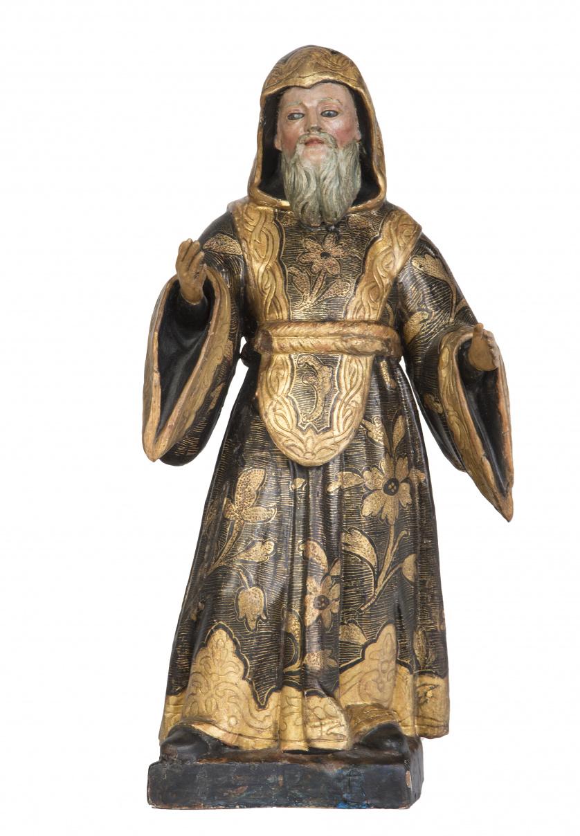 Santo de madera tallada, dorada y policromada, con ojos de